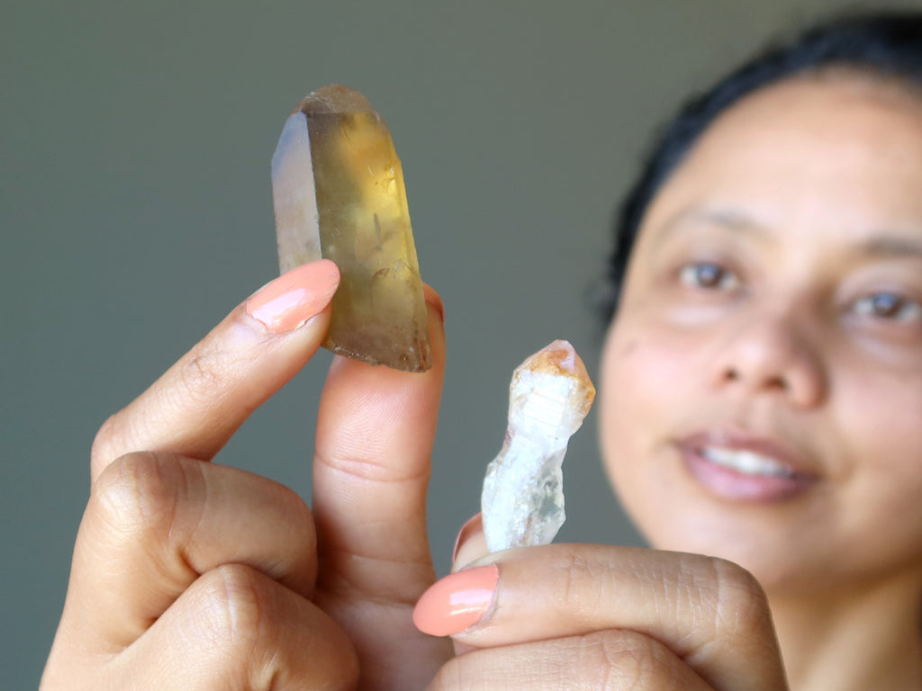 sheila of satin crystals holding real and heat treated citrine points
