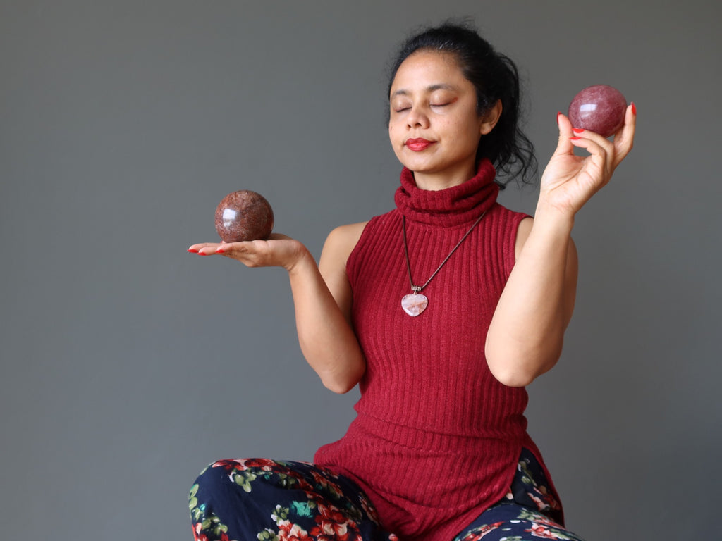 sheila of satin crystals meditating with red quartz spheres