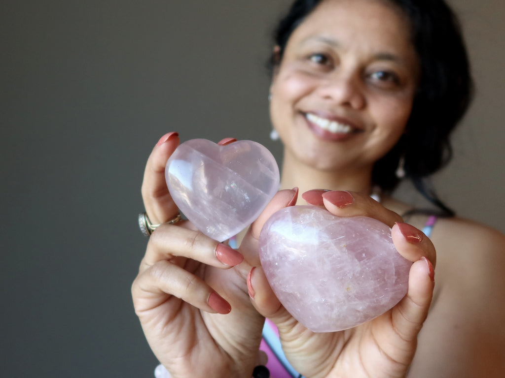 sheila of satin crystals holding two pink rose quartz hearts
