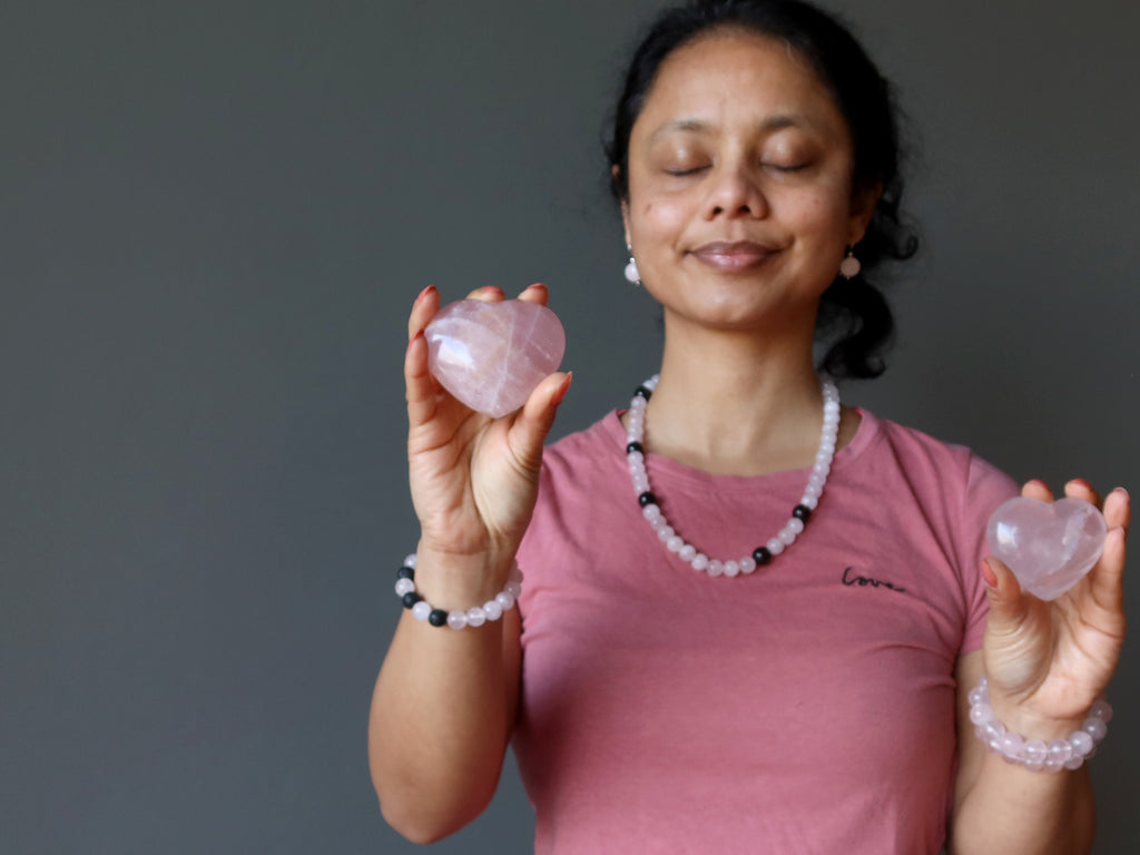 sheila of satin crystals holding two rose quartz hearts