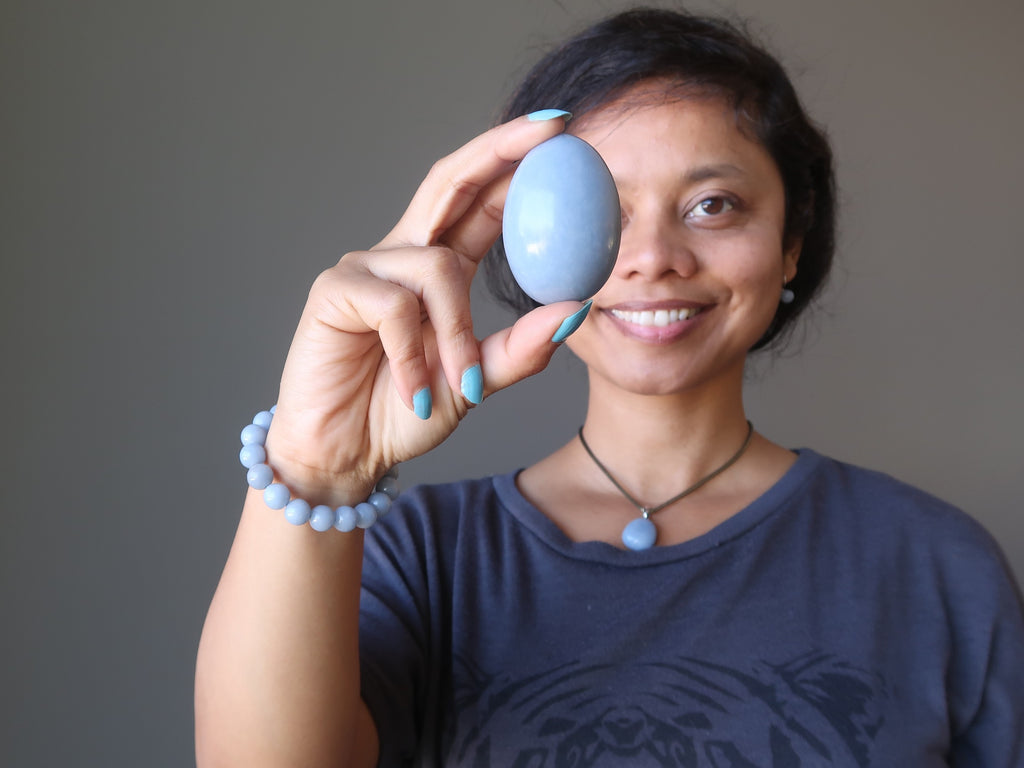 sheila of satin crystals holding an angelite stone egg for shop by intentions page