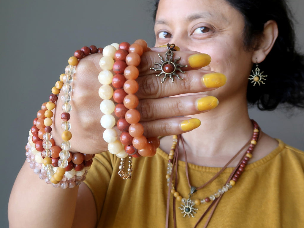 Sheila of Satin Crystals with a handful of bright sun inspired jewelry