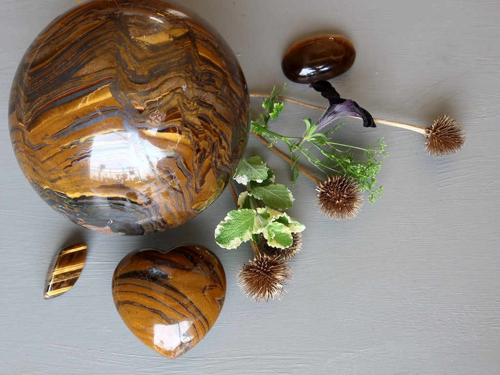 tigers eye stones and greenery
