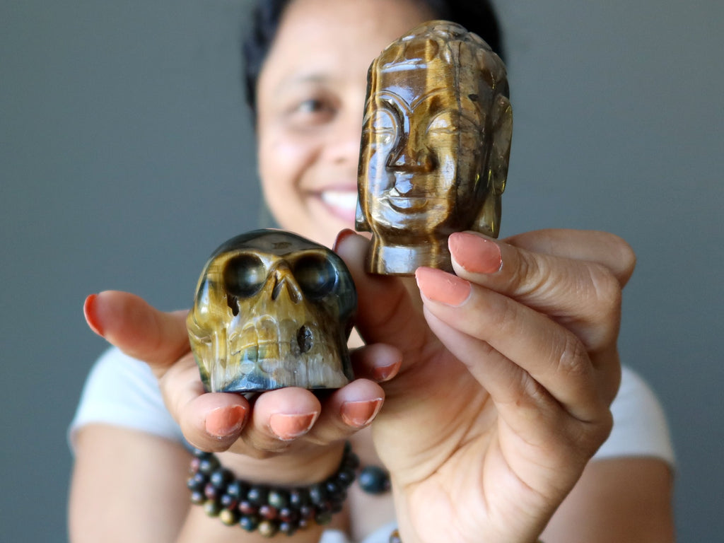 sheila of satin crystals holding a tigers eye skull and buddha head