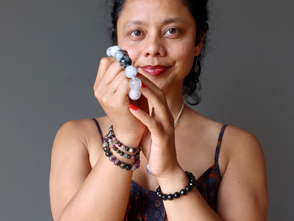 sheila of satin crystals holding and wearing tourmaline bracelets