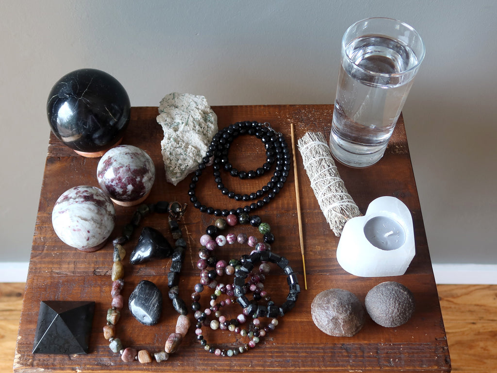 tourmaline, sage, candle, moqui marbles, water for meditation