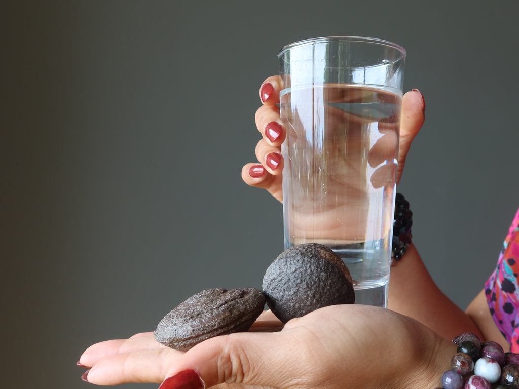moqui marbles and glass of water