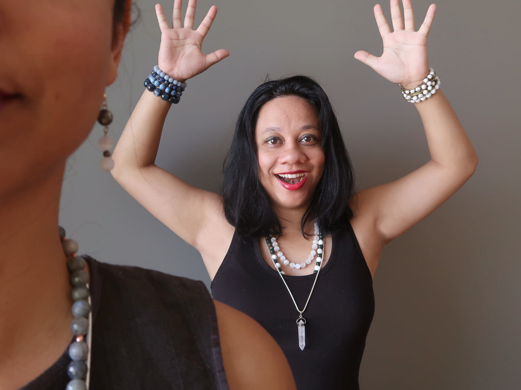 Lisa Satin with arms up in excitement