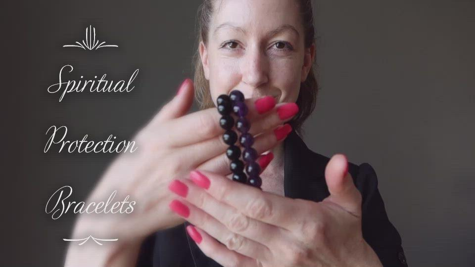 video of female modeling black tourmaline and amethyst bracelet set