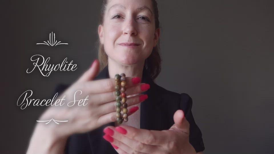 video of female modeling rhyolite bracelets at satin crystals