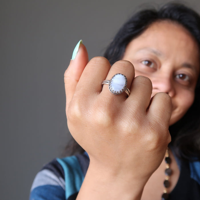 sheila of satin crystals wearing a blue lace agate ring