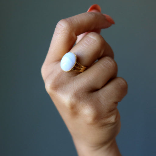 hand wearing blue lace agate oval in gold tone adjustable ring