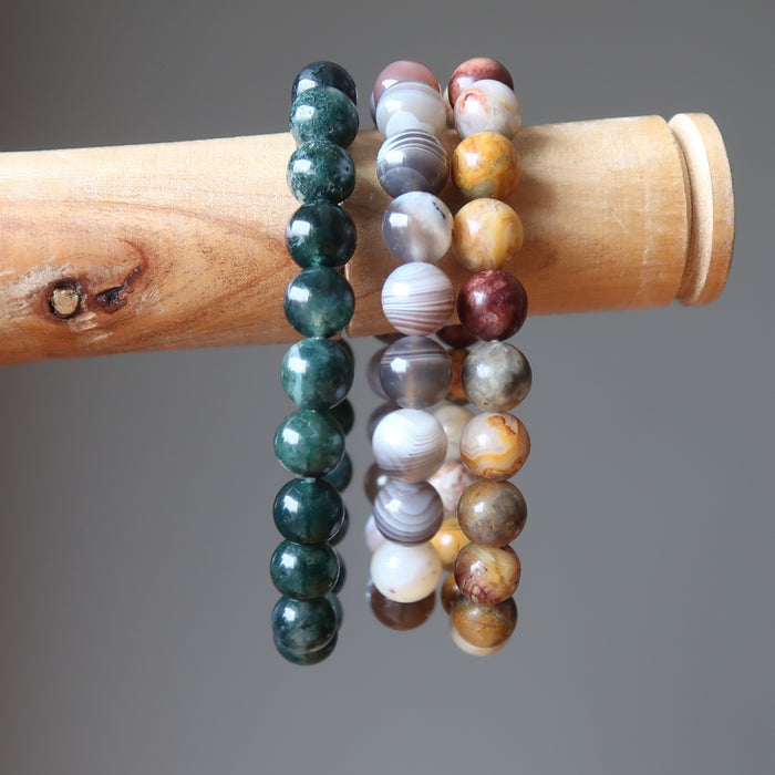 botswana, crazy lace and moss agate round beaded stretch bracelet set on stick