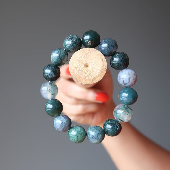 green and white moss agate round beaded stretch bracelet on a stick