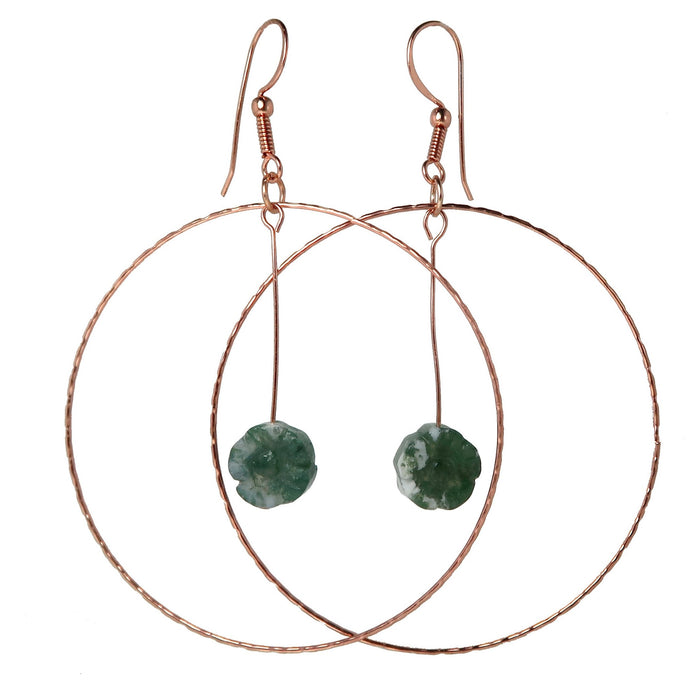moss agate flower beads hanging in copper hoop earrings