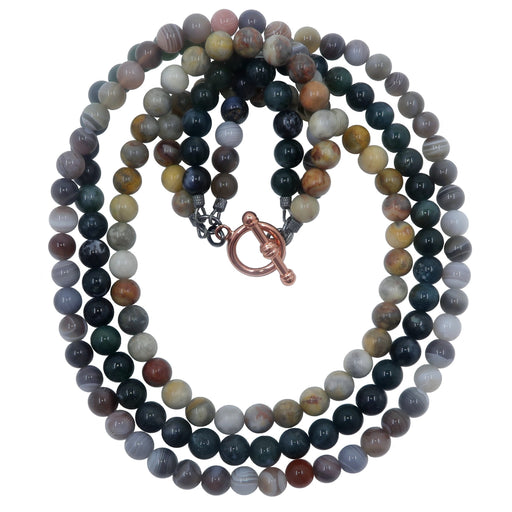 triple strand necklace featuring botswana, moss and crazy lace agate beads