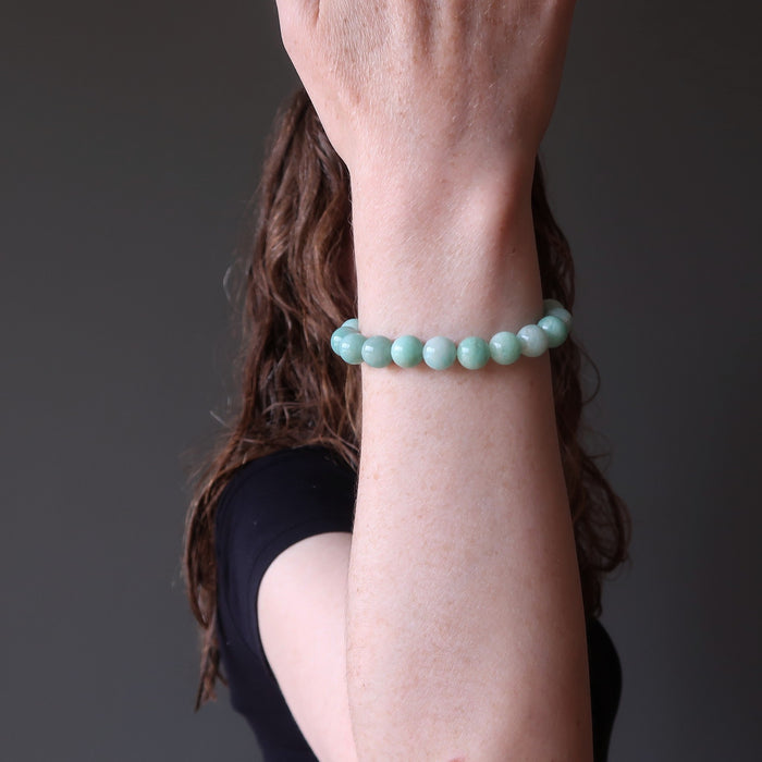female model showing off an amazonite stretch bracelet