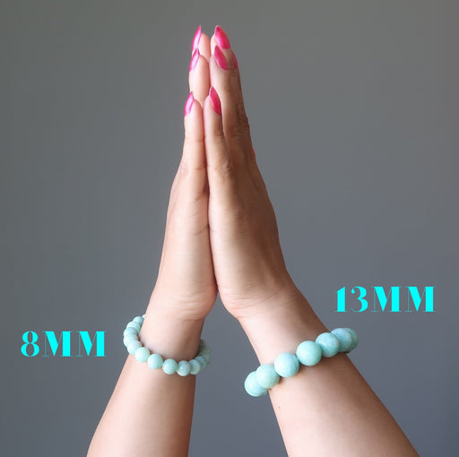 hands in prayer wearing a 8mm and a 13mm amazonite bracelet