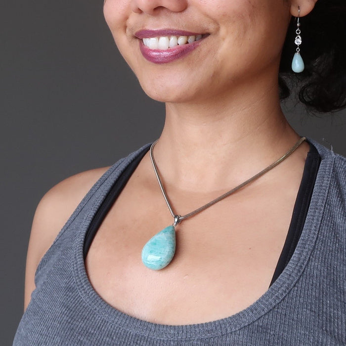 model wearing amazonite tear drop pendant on chain with amazonite earrings