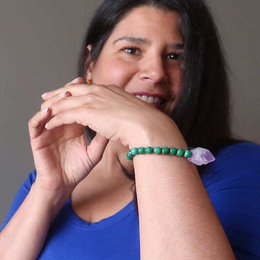 A model smiles while wearing her malachite amethyst gemstone bracelet