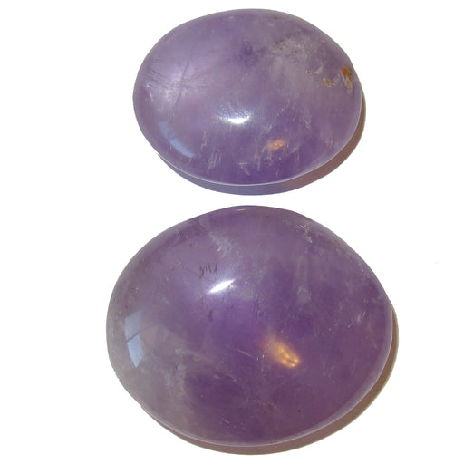 two purple amethyst polished palm stones of different sizes
