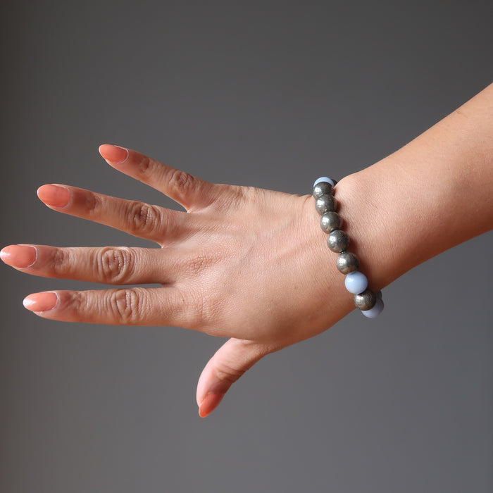 female hand modeling angelite pyrite stretch bracelet