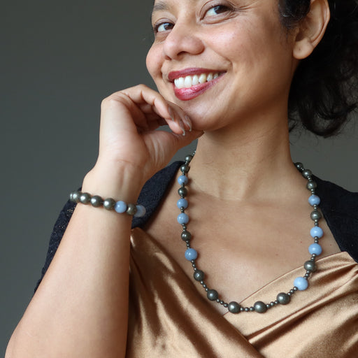 sheila of satin crystals wearing pyrite and angelite beaded necklace and bracelet