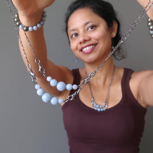 sheila of satin crytals holding angelite necklaces