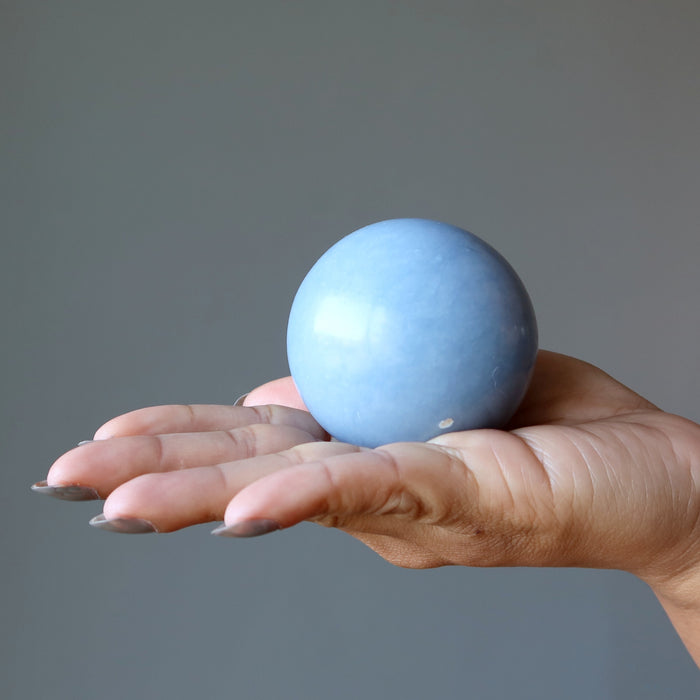 angelite sphere in palm of hand