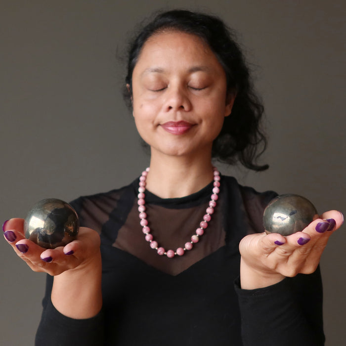 sheila of satin crystals meditating two apache gold spheres in her palms