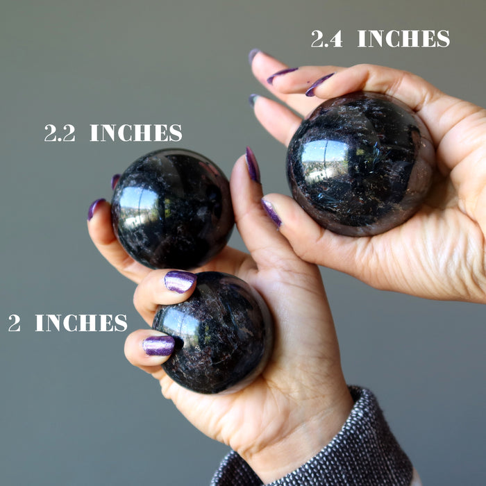 three arfvedsonite spheres to show varying sizes
