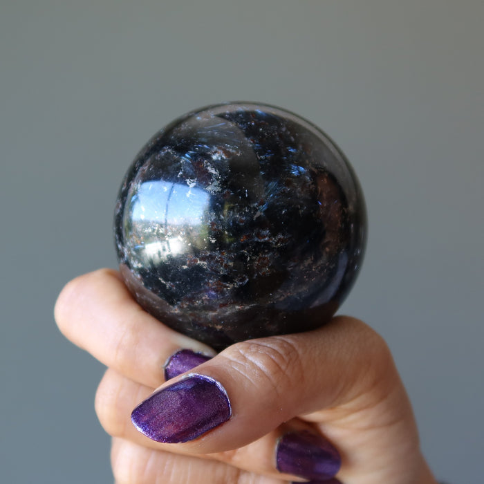 holding arfvedsonite sphere in fist