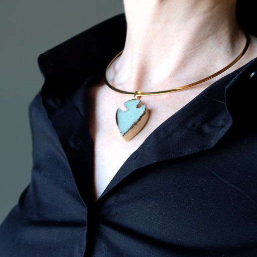 woman's neck modeling green aventurine arrowhead necklace