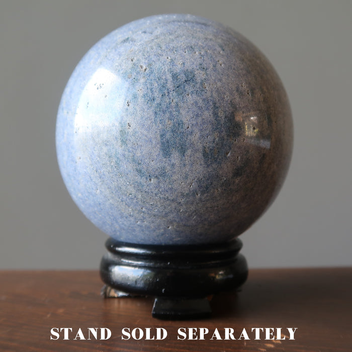 blue aventurine sphere on a wood display stand