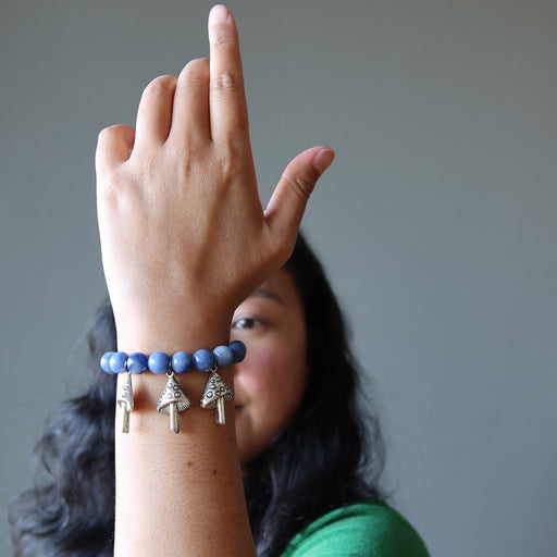 jessica of satin crystals with hand up admiring her blue aventurine mushroom stretch bracelet