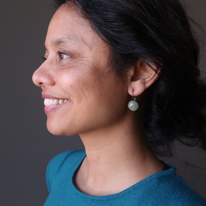 sheila of satin crystals wearing green aventurine in bronze leverback earrings