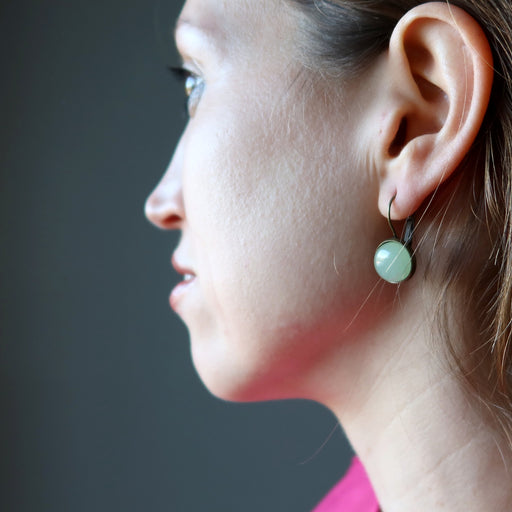 holly of satin crystals wearing green aventurine in bronze leverback earrings