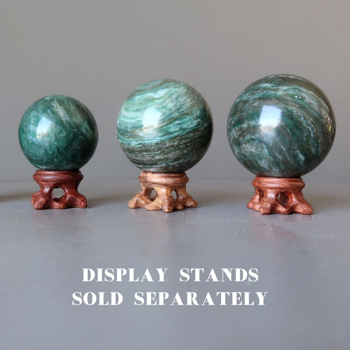 three aventurine spheres on wood display stands which are sold separately
