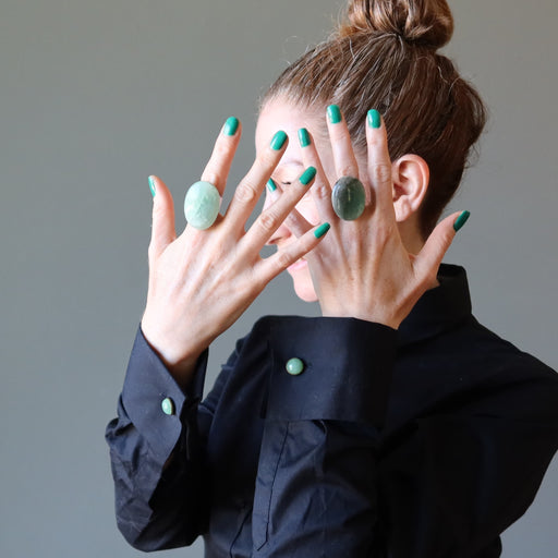 woman wearing two aventurine rings