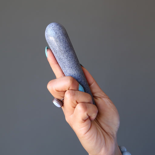 hand holding blue aventurine tapered massage wand