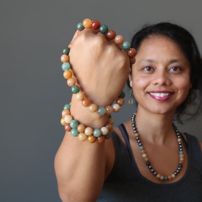 sheila of satin crystals with an armful of multi colored aventurine stretch bracelets
