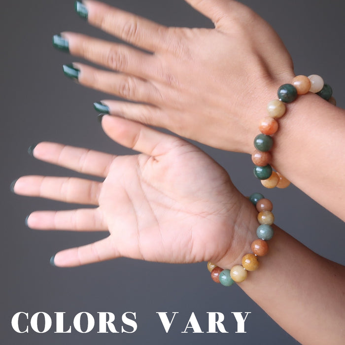 two hands wearing multi colored aventurine stretch bracelets showing colors vary