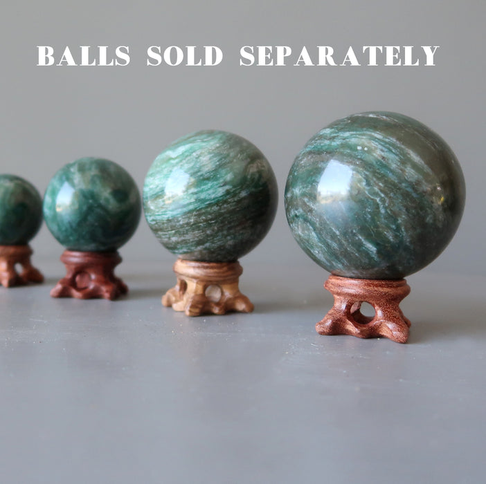 4 green aventurine spheres on set of 4 fancy crystal ball display stands in varying shades of brown wood sold separately