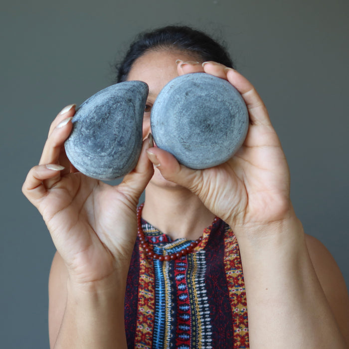 sheila of satin crystals holding pair of male and female basalt massage stones