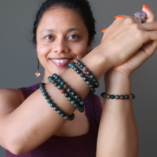sheila of satin crystals wearing a stack of faceted bloodstone bracelets