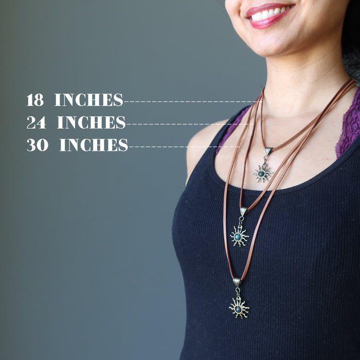 sheila of satin crystals wearing three bloodstone sun necklace on leather cords to show different lengths