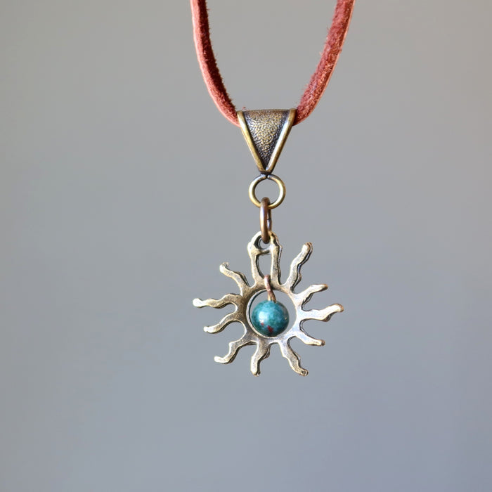 back side of bloodstone sun necklace on leather cord