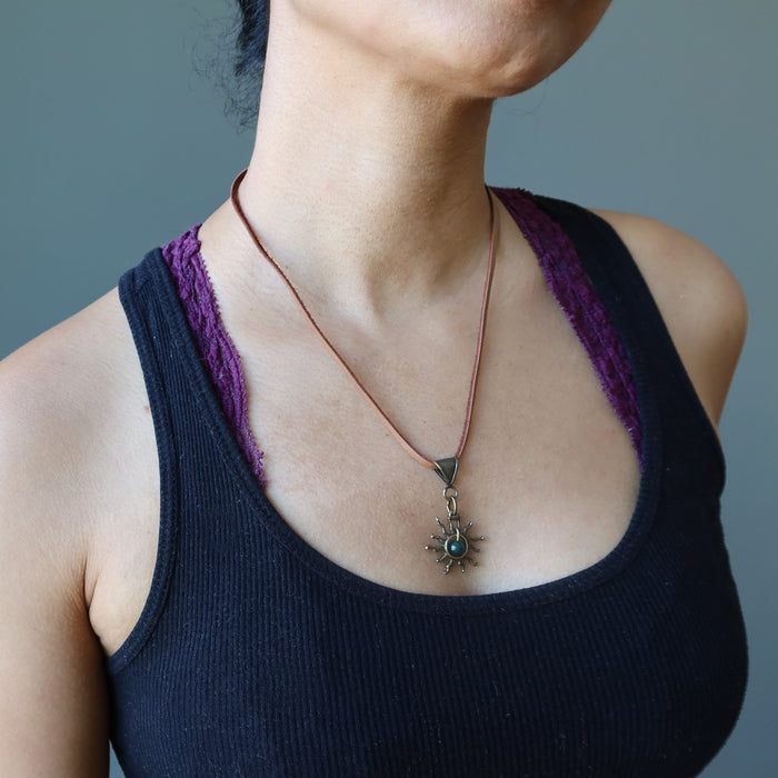sheila of satin crystals wearing a bloodstone sun necklace on leather cord