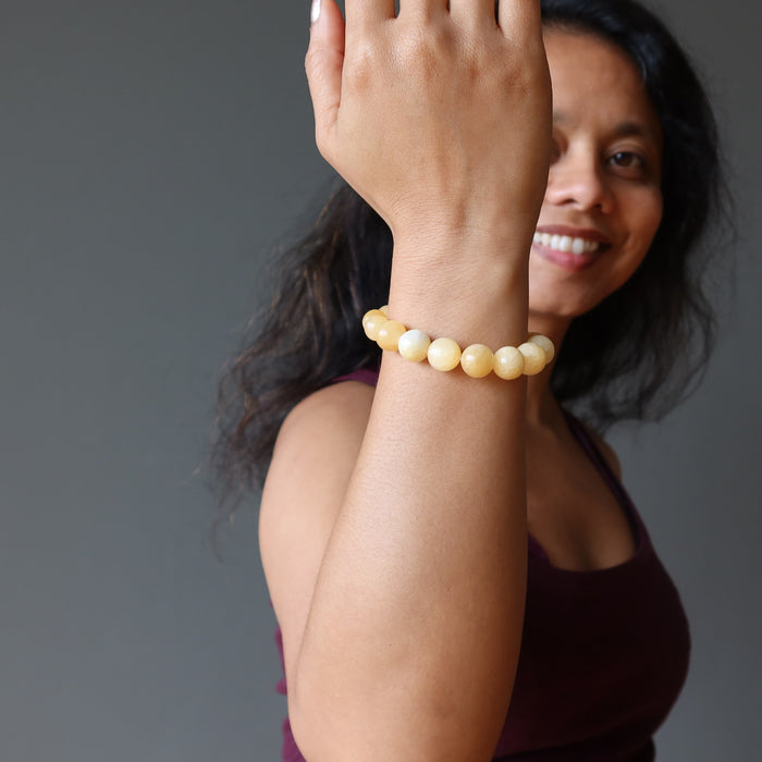 sheila of satin crystals wearing a yellow calcite beaded stretch bracelet