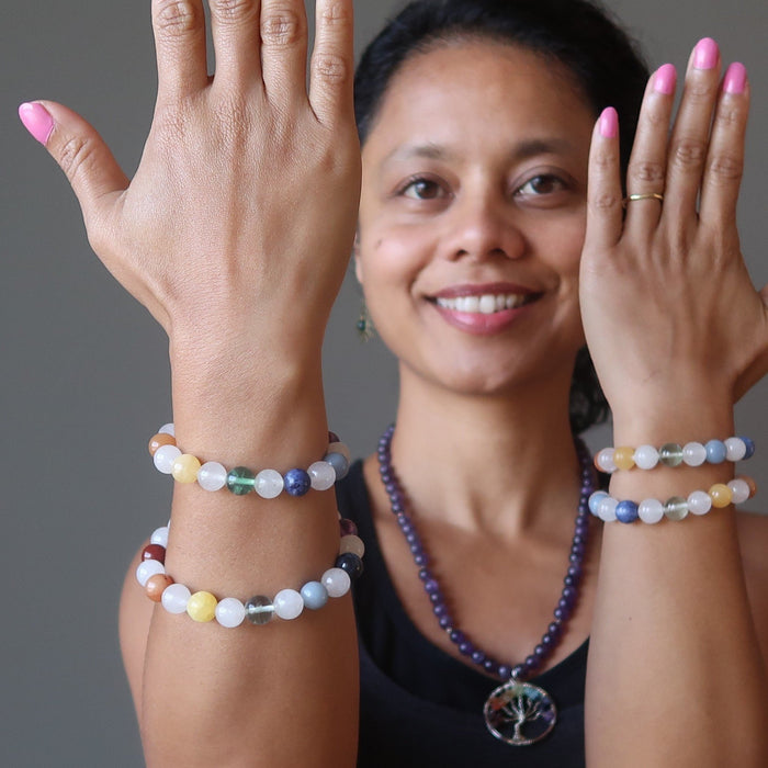 sheila of satin crystals wearing 4 snow white quartz chakra bracelets